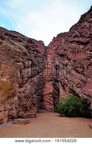 Long shot of the Devil's throat or Garganta del diablo a unique rock formation in the Canyon Quebrada de las conchas close to Cafayate in Chile South America