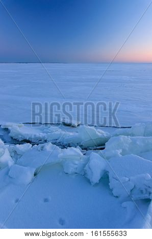 Sunset at Frozen Winter River Volga Russia. ice floe