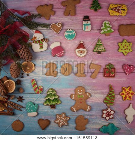Different ginger cookies for new 2017 year holiday on wooden background, xmas theme. Toned photo.