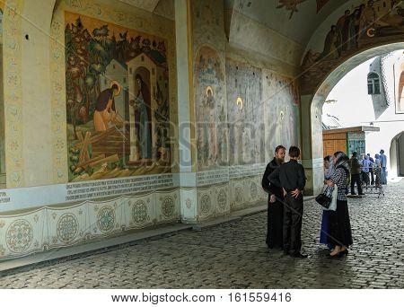 Sergiev Posad, Russia - September 1, 2009: Priests in Trinity Sergius Lavra monastery. Popular touristic landmark, UNESCO World Heritage Site