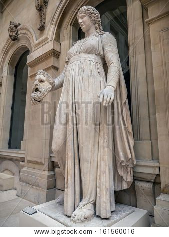 PARIS, FRANCE - AUGUST 28 2013: Colossal female statue, muse Melpomene. Marble, Roman artwork, ca. 50 BC. Louvre Museum