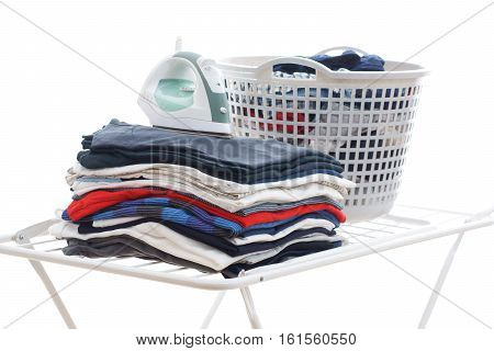Electronic Ironing And Pile Of Clothes On Board On Isolated White Background