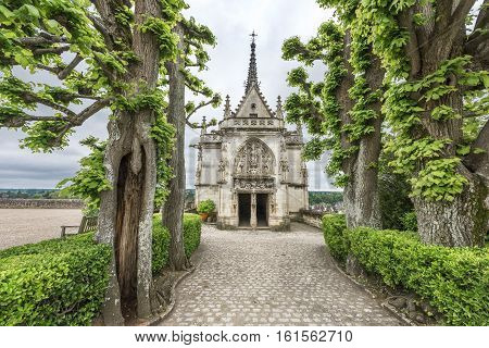 Amboise, France - June 2016: Park view on the chapel of Amboise castle