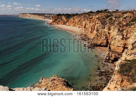 View on Praia de Porto de Mos , natural rocks and beaches at Lagos Portugal