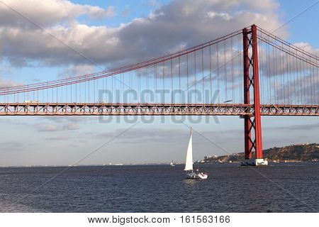 Famous 25 de Abril bridge over Tagus in Lisbon, Portugal