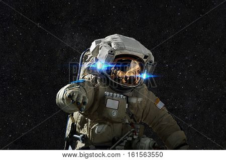 Spaceman In Space On The Background Of Stars.