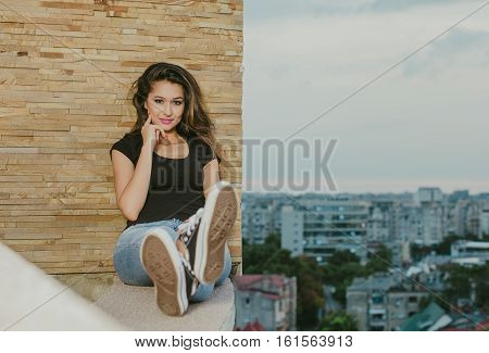Beautiful portrait of a sexy woman, posing at wall
