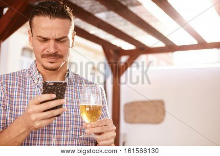 Man With A Beer And Cellphone