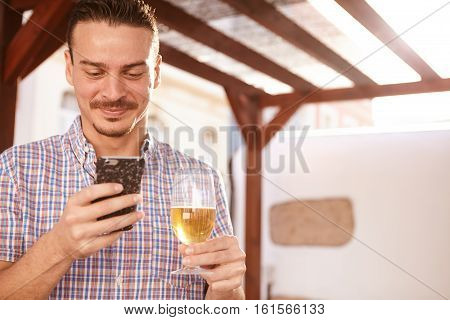 Smiling Man With Beer And Cellphone