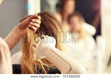 Picture showing hairdresser holding hair dryer