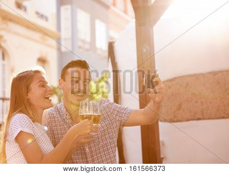 Selfie Taking Couple With Some Beer