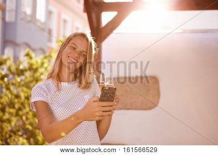 Smiling Blond With Beer Looking At Cellphone