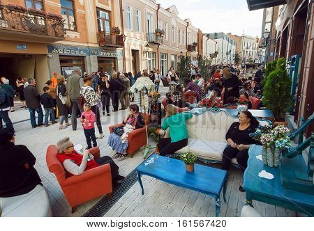 TBILISI, GEORGIA - SEP 25, 2016: Many relaxed people walking in historical area of the city with outdoor restaurants on September 25, 2016. Tbilisi has population of 1.5 million people