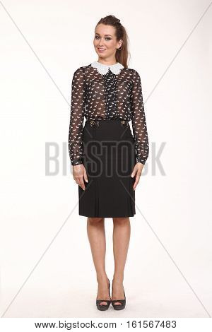 brown hair woman with straight hair style in sheer white collar blouse and skirt high heel shoes going full body length isolated on white