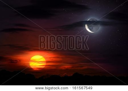 Sun and moon together on the sky symbolizing time opposites harmony etc