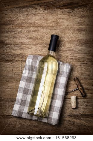 Wine Bottle, Corkscrew On Wooden Table