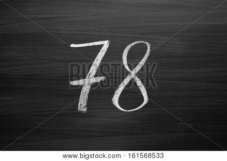 number seventy eight enumeration written with a chalk on the blackboard