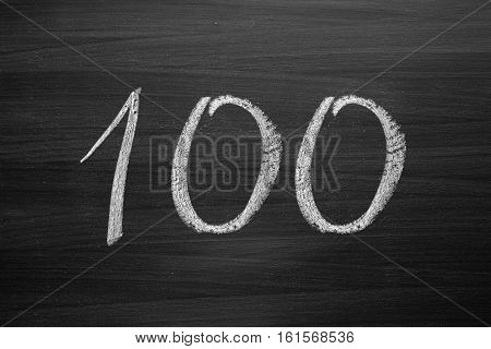 number one hundred enumeration written with a chalk on the blackboard