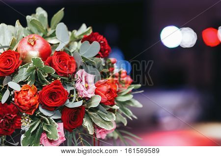 Gorgeous Bouquet Of Roses And Ranunculus Decorated With Pomegranate