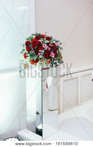 Bouquet Of Roses And Greenery Stands  On The Glass Box