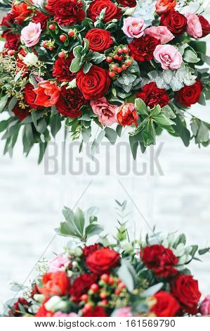 Rich Red Bouquets Of Roses, Peonies And Ranunculus In The Glass Vase