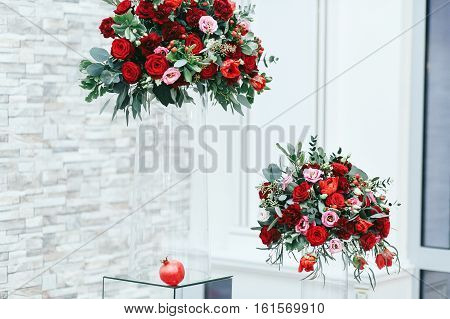 Red Nosegays In High Glass Vases And Lonely Pomegranate