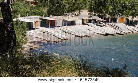 Boathouses in Sa caleta, Ibiza, near water