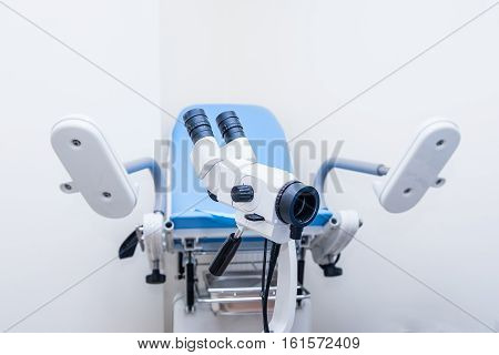 Close up colposcope on the background of gynecological chair