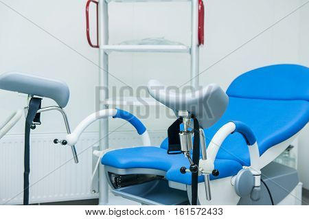Gynecological surgery room with chair and equipment