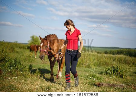 Happy Woman with her Horse - Beautiful young horsewoman next to her horse. equestrian