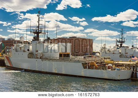 Boston, USA - April 28, 2015: Large white ship moored in the harbor in Boston the United States. The city is located near plenty of water facilities and using boats and ships are very frequent. There are many boat tours.