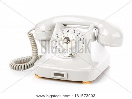 Retro rotary phone on a white background