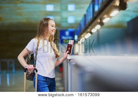 Beautiful Young Tourist Girl In International Airport At Check-in Counter