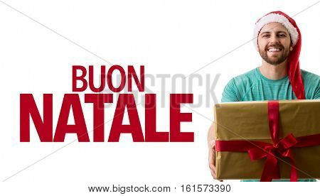 Man holding a Christmas gifts and Merry Christmas written (Buon Natale: Italian)