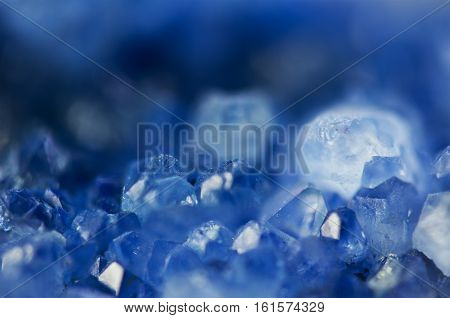 Dark blue crystal natural nature mineral texture stone. Macro