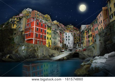 view of a beautiful village of Riomaggiore by night, Liguria Italy