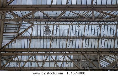 Glasshouse roof detail detail showing metal girders and frames