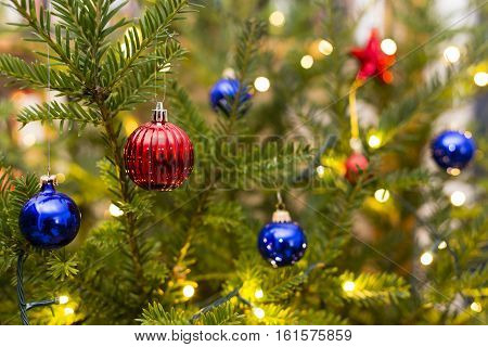 Part of a christmas tree with ornaments and lights
