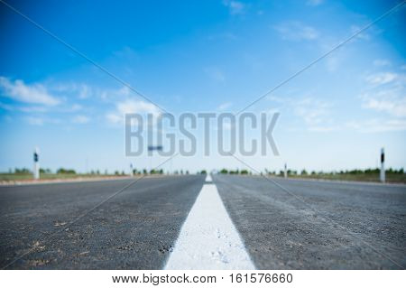 Close-up of the white line on an empty highway