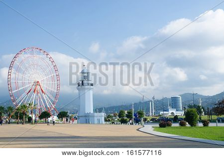 BATUMI GEORGIA - OCTOBER 7: Ferris wheel and old lighthouse situated in Miracle Park at city seafront on October 7 2016 in Batumi Georgia.
