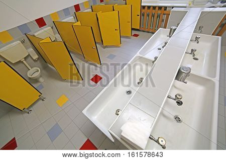 Bathroom With Small Water Closet And Ceramic Sinks