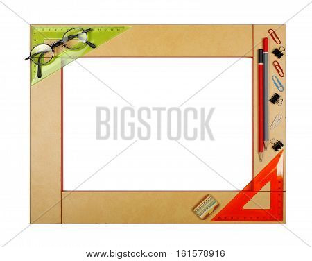 Yellow art school frame with stationery - ruler square protractor eraser pencil glasses paper clips binder clip on a white background. Isolated