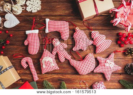 Red gingham toys on the table. Christmas greetings