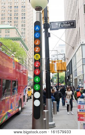 NEW YORK - MAY 2 2016: Information pole about different subway lines on Fulton Street