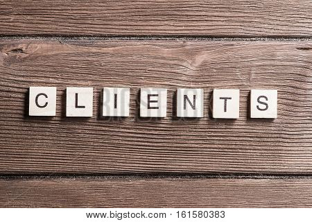 Business conceptual word clients collected from wooden elements with the letters