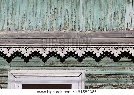 artsy decor trim and classic old wooden house. triangular patterns and wood texture turquoise color