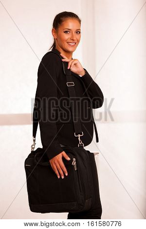 Business Woman In Formal Suit Wtih A Bag Over Her Shoulder