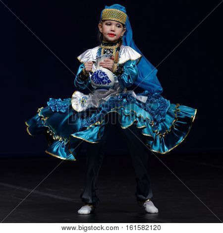 ST. PETERSBURG, RUSSIA - OCTOBER 28, 2016: Teen female dancer performing in the International festival-contest of vocal and choreographic art Autumn Transformation