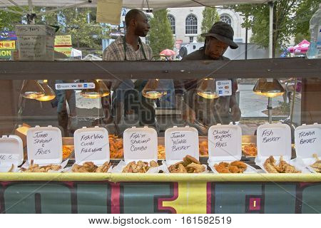 Asheville, North Carolina, USA - September 10, 2016: Food booth displaying their delicious fast food at the African American Goombay Festival on September 10, 2016 in downtown Asheville NC, USA