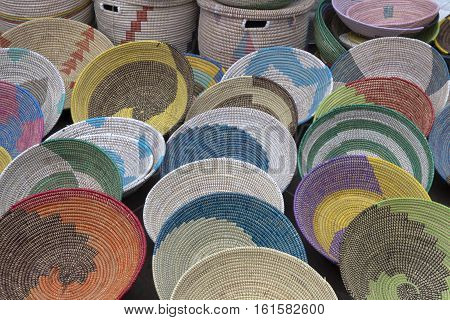 Asheville, North Carolina, USA - September 10, 2016: A variety of colorfully woven artistic African baskets for sale at a Goombay festival on September 10, 2016 in downtown Asheville, NC